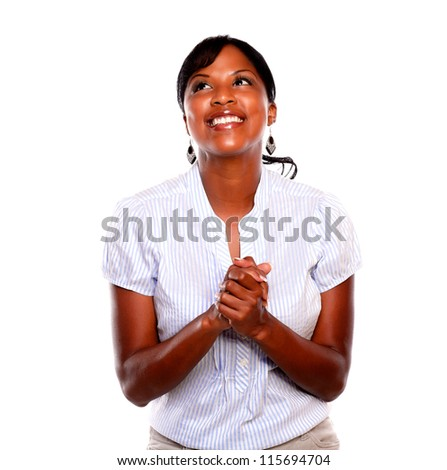 Smiling afro-american woman celebrating and looking up against white background - stock photo