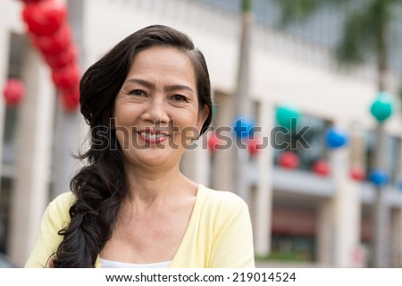 Smiling aged woman looking at the camera