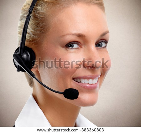 Smiling agent woman with headsets.