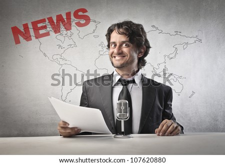 Smiling anchorman about to read the news - stock photo