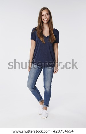 Smiling and confident young woman, portrait - stock photo