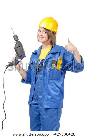 smiling and showing thumb up construction female worker in yellow helmet and blue workwear with drill isolated on white background. proposing service. advertisement gesture