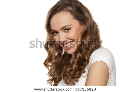 smiling and shy pretty girl on a white background