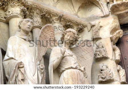 Smiling angel. Notre-Dame de Reims Cathedral. Reims, France  - stock photo