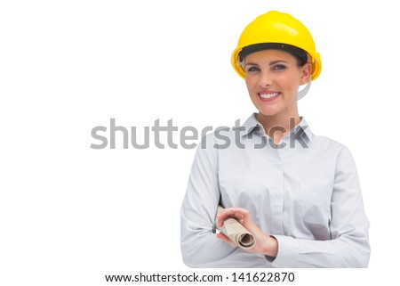 Smiling architect holding rolled up plan on white background - stock photo
