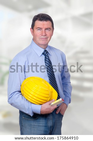 smiling architect in the house - stock photo