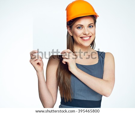 Smiling architect woman hold blank sign board. Isolated portrait. - stock photo