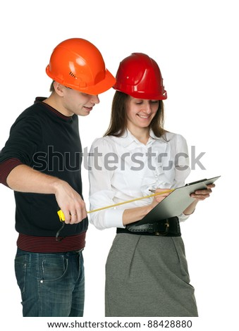 Smiling architects in hard hats discussing details of  construction process; isolated on white