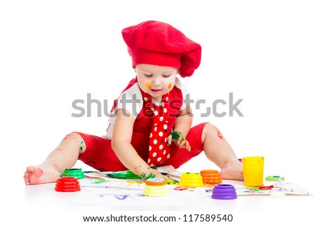 smiling artist child painting with finger - stock photo