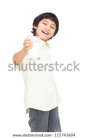 Smiling asian boy with a glass of milk, Isolated over white background with clipping path - stock photo
