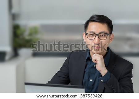 Smiling Asian Businessman in the Office - stock photo