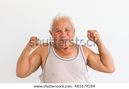 smiling asian fat old man in undershirt with fighting sign on blank background.