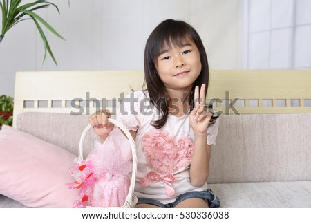 smiling Asian girl with gift