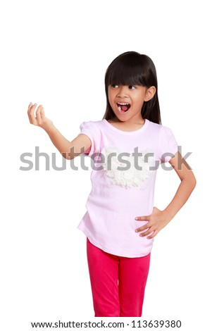 Smiling asian little girl showing empty copyspace on open hand, Isolated on white - stock photo