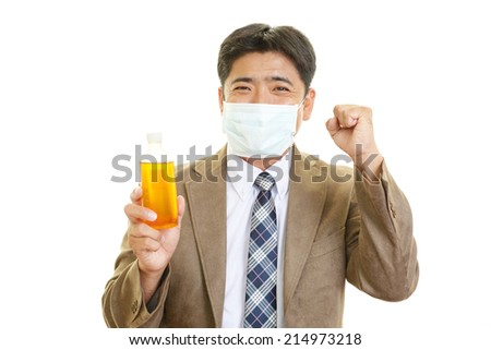 Smiling Asian man with medicine