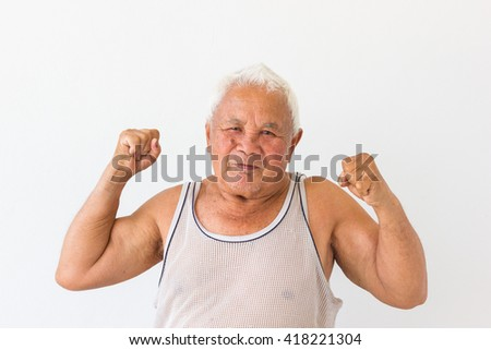 smiling asian old man in undershirt with fighting sign on blank background.