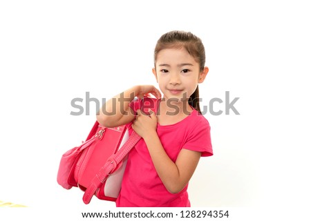 Smiling Asian schoolgirl - stock photo