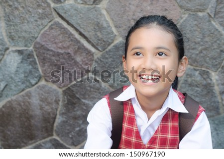 smiling asian schoolgirl with ponytail  - stock photo