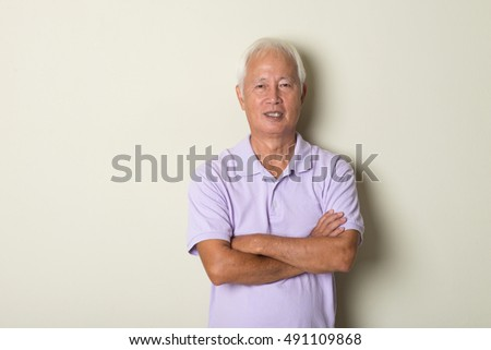 smiling asian senior male