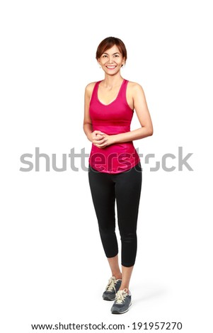 Smiling asian woman in sports wear, Isolated over white - stock photo