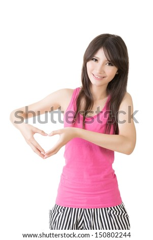 Smiling asian woman make heart shape. Isolated on the white background.