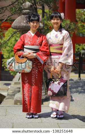 Smiling Asian Women in Kimono dress - stock photo