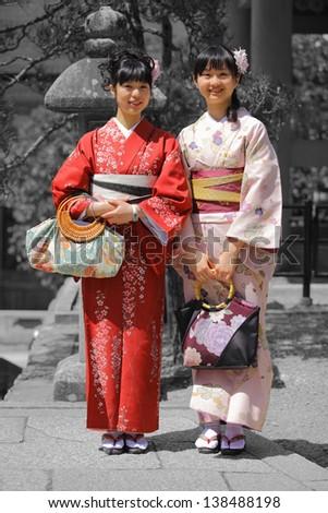 Smiling Asian Women wearing Kimono - stock photo