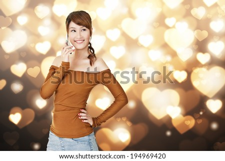 Smiling Asian young woman use cellphone, closeup portrait. - stock photo