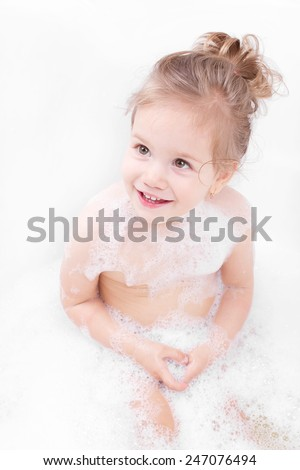 Smiling at the bath little girl