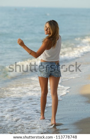 Smiling at the beach - stock photo