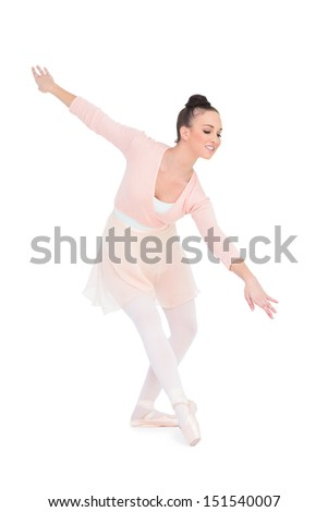 Smiling attractive ballerina dancing on white background
