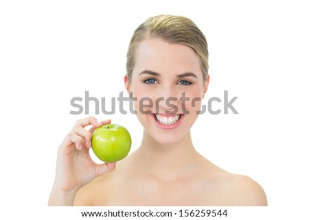 Smiling attractive blonde on white background holding green apple