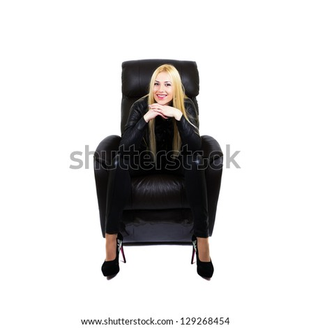 Smiling attractive blonde sitting on the couch with her hands under her chin. White background - stock photo