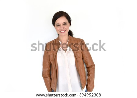 Smiling attractive brunette woman on white background - stock photo