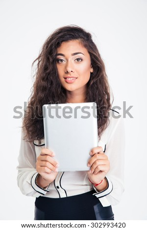 Smiling attractive businesswoman holding tablet computer isolated on a white background and looking at camera - stock photo