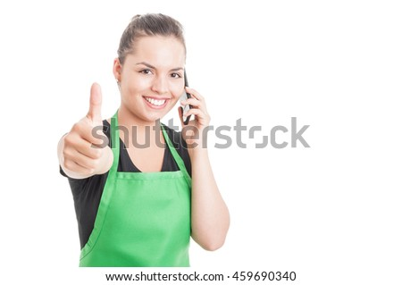 Smiling attractive employee calling somebody and doing like gesture isolated on white with copyspace area - stock photo