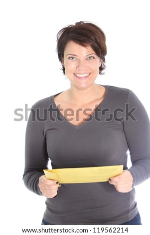 Smiling attractive woman holding a brown envelope in her hands isolated on white - stock photo