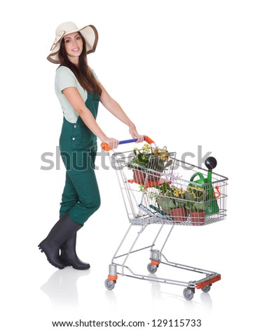 Smiling Attractive Woman Holding Shopping Cart. Isolated On White
