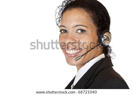 Smiling attractive woman makes with headset a call. Isolated on white background.