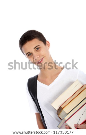 Smiling attractive young teenage boy carrying a pile of books under his arm as he makes his way to classes at college isolated on white