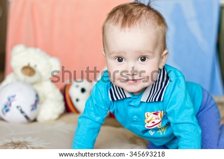 Smiling baby boy portrait with toys - stock photo