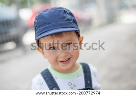 smiling baby boy with blue hat