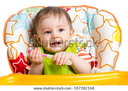 smiling baby boy with spoon
