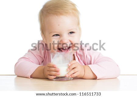 smiling baby drinking yogurt or kefir over white