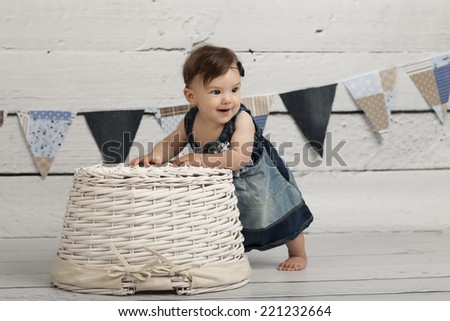 Smiling Baby Girl in basket - stock photo