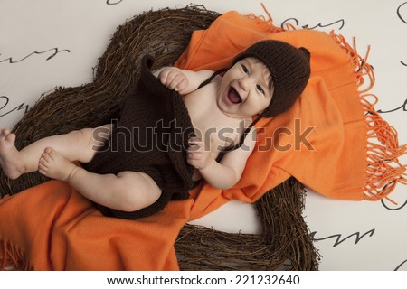 Smiling Baby Girl in heart - stock photo