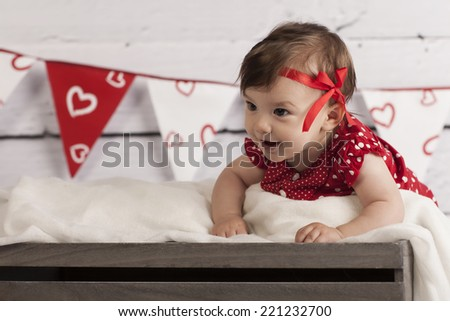 Smiling Baby Girl in red dress