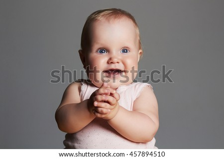 smiling baby girl. little funny child.newborn - stock photo