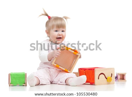 smiling baby girl playing with color educational toy - stock photo