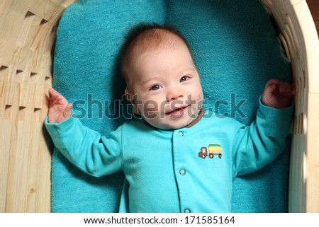 smiling baby in blue - stock photo